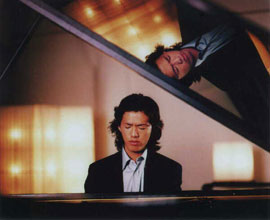 Yundi Li is mirrored at the piano